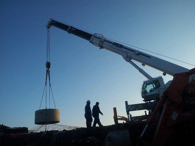 precast concrete tank installation with crane